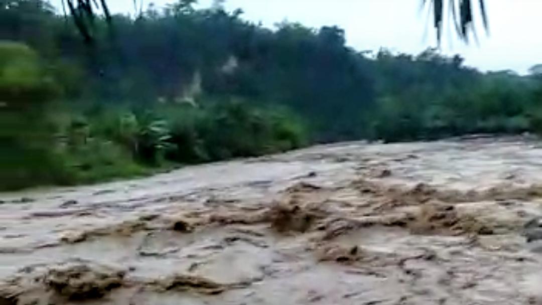 Banjir akibat bendungan meluap terjang kawasan Sibiru-biru. Foto: Istimewa