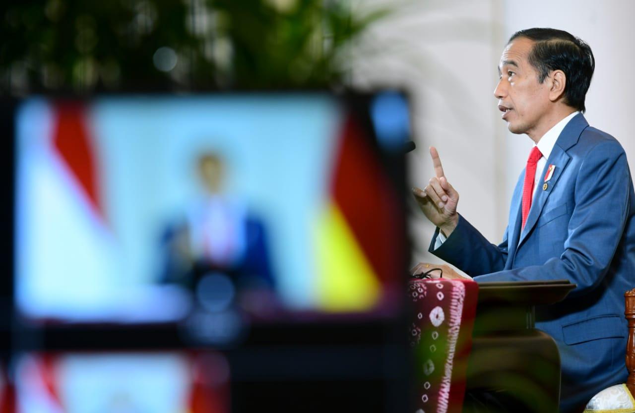 Presiden Jokowi saat pertemuan bilateral virtual dengan Kanselir Jerman Angela Merkel. Foto: Istimewa